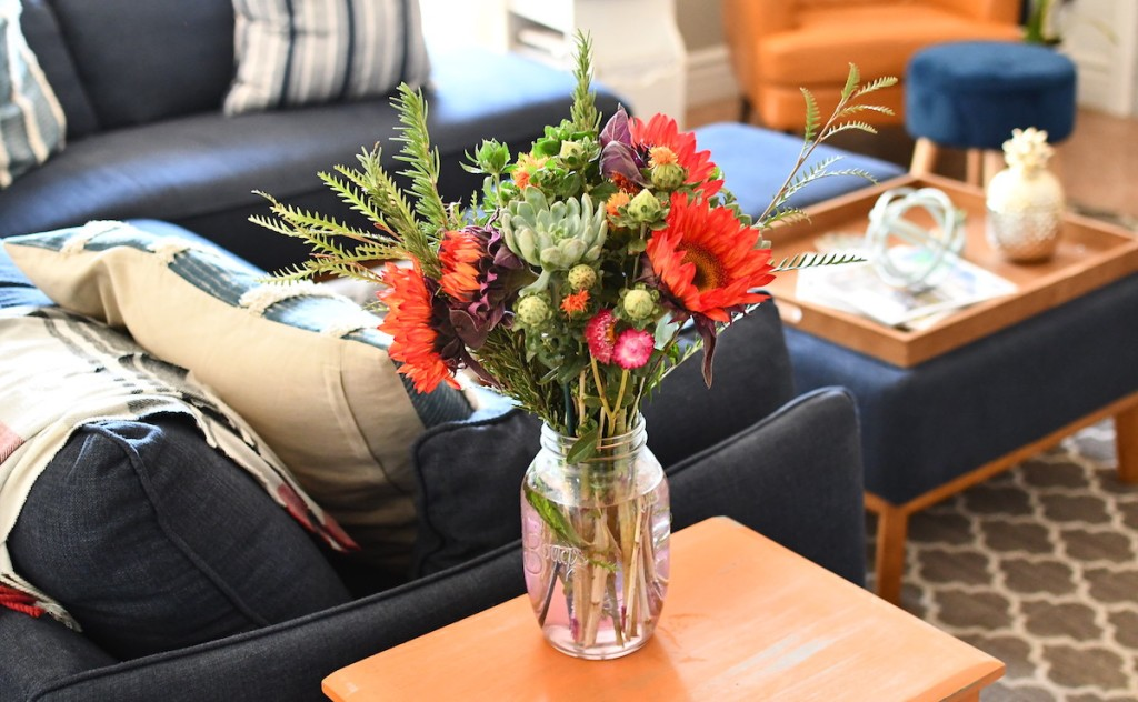 bouquet of flowers sitting on end table in living room - selling your home