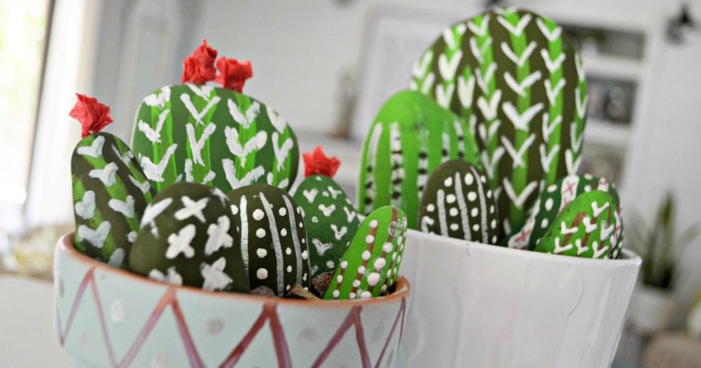 painted cactus rocks in planter pots