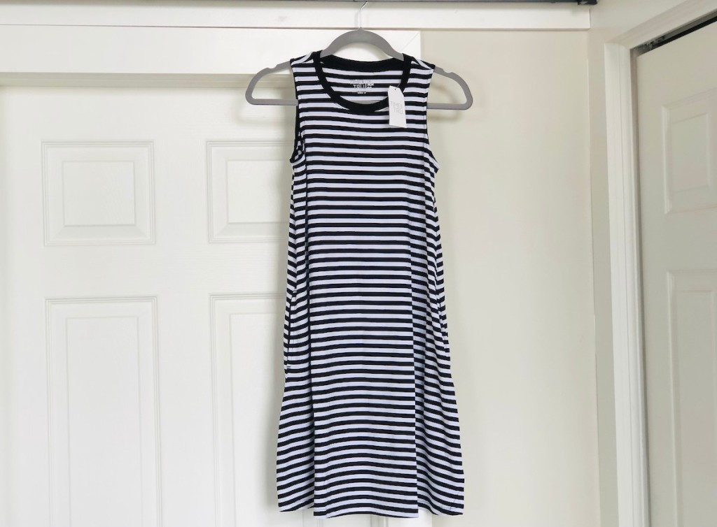 black and white striped dress hanging above door