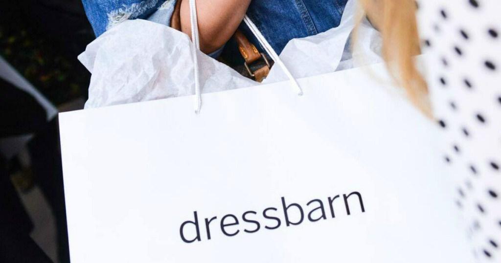 woman holding dressbarn shopping bag