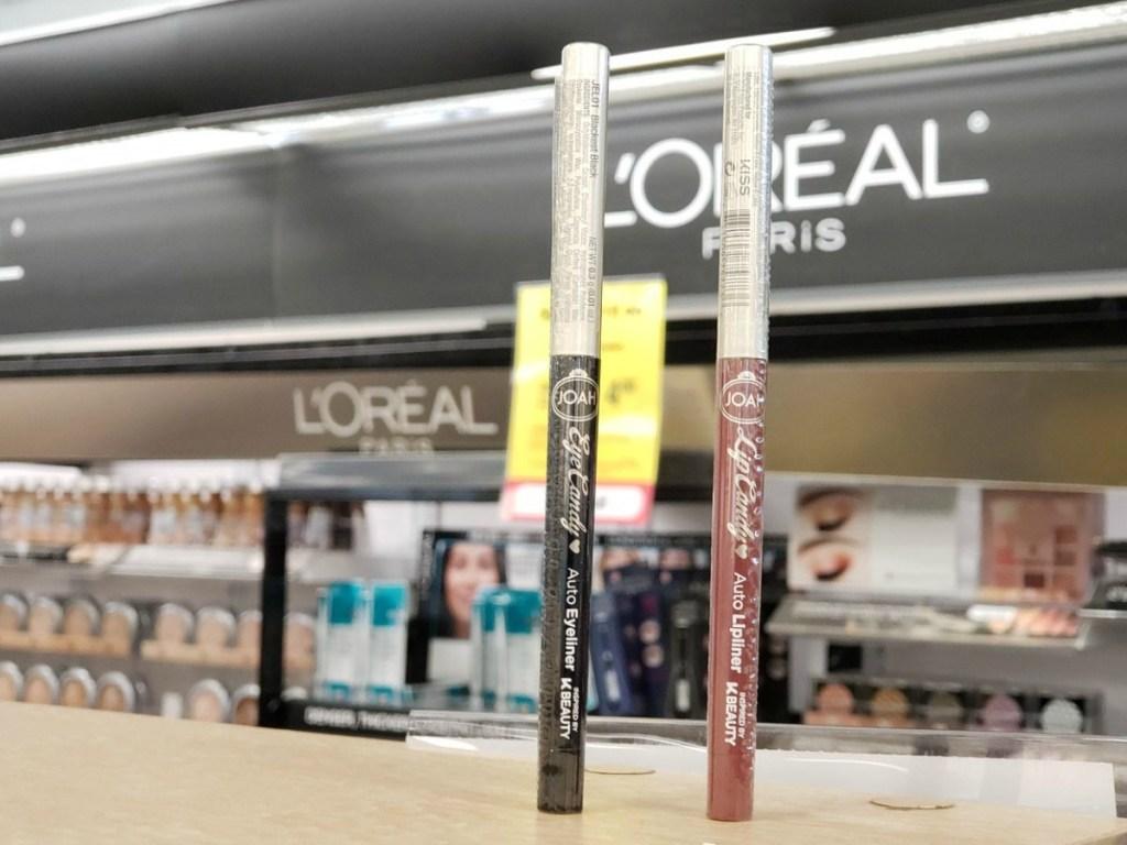 eye liner and lip liner on shelf