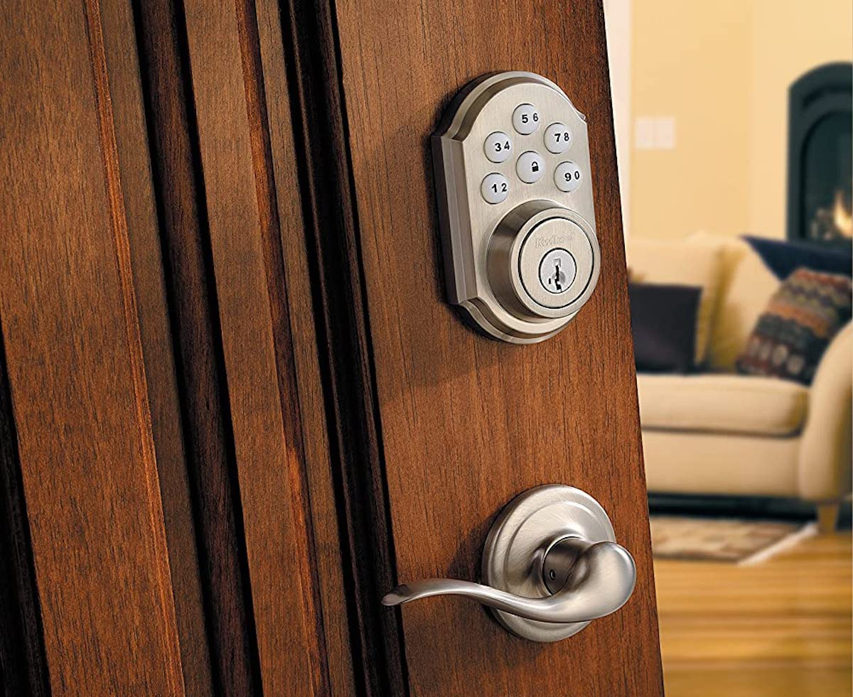 wood door with silver door knob and keyless door lock key pad