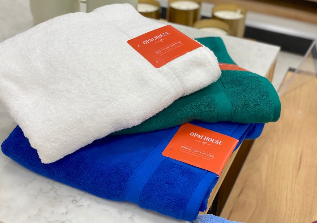 stack of colorful bath towels on marble top table
