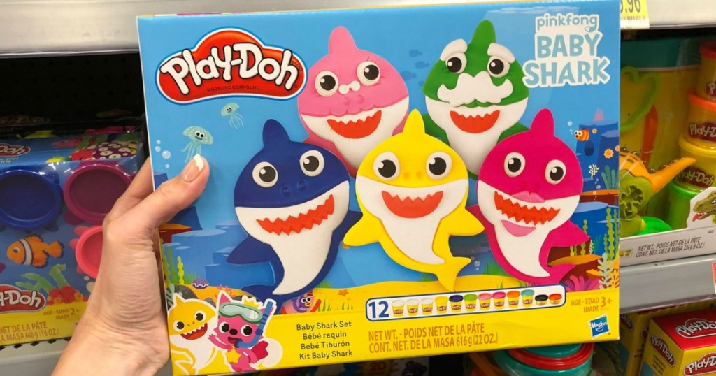 hand holding play doh set by store display
