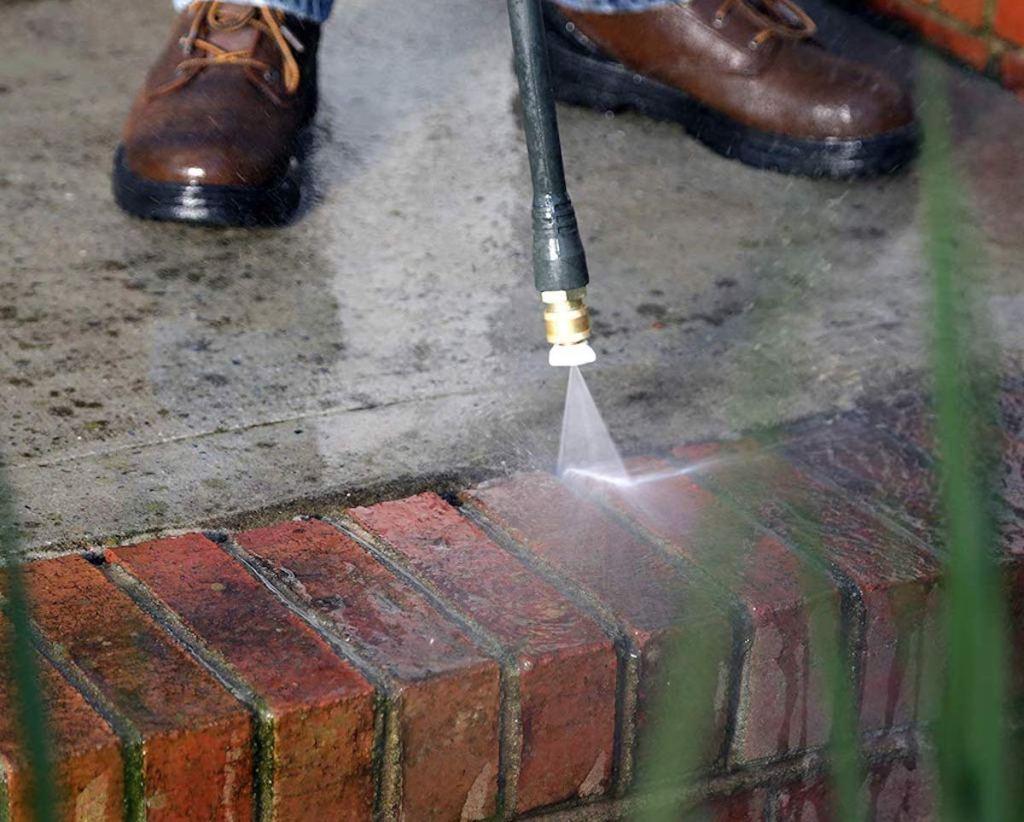 hose power washing brick sidewalk - selling your home