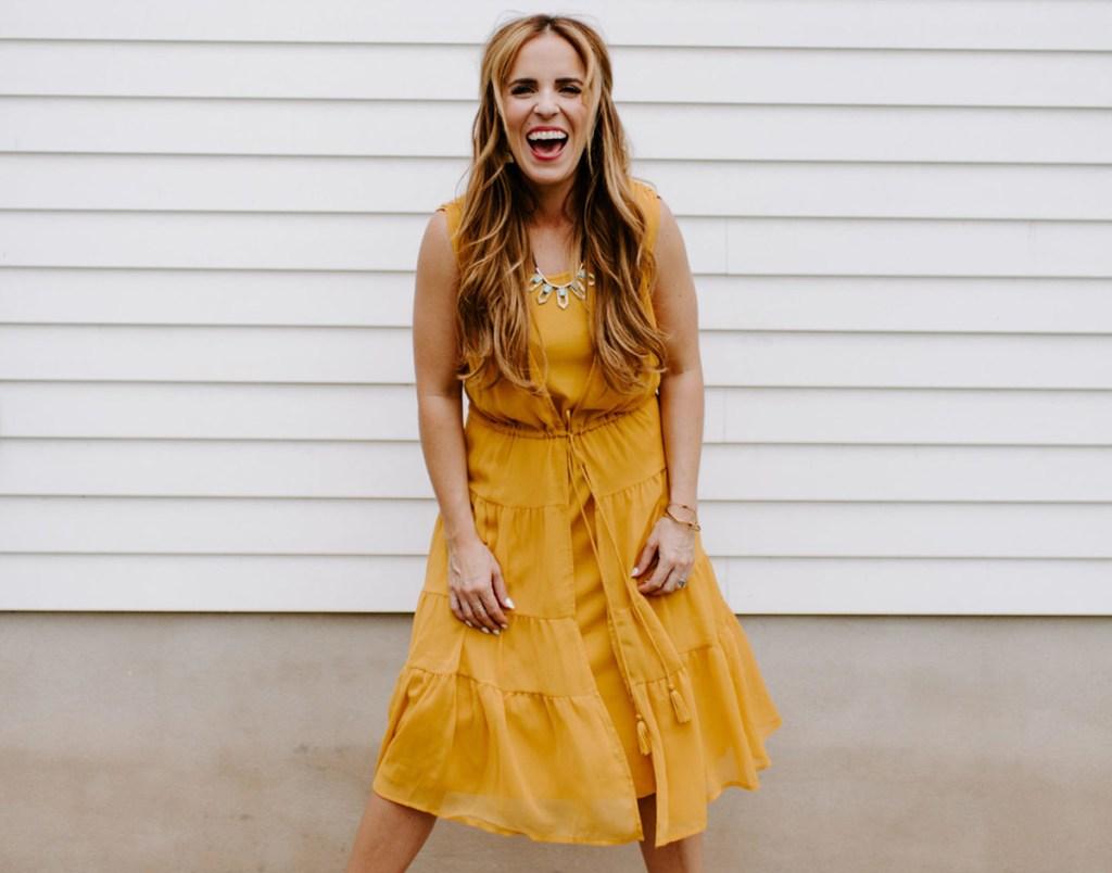 rachel hollis wearing mustard yellow sheer dress
