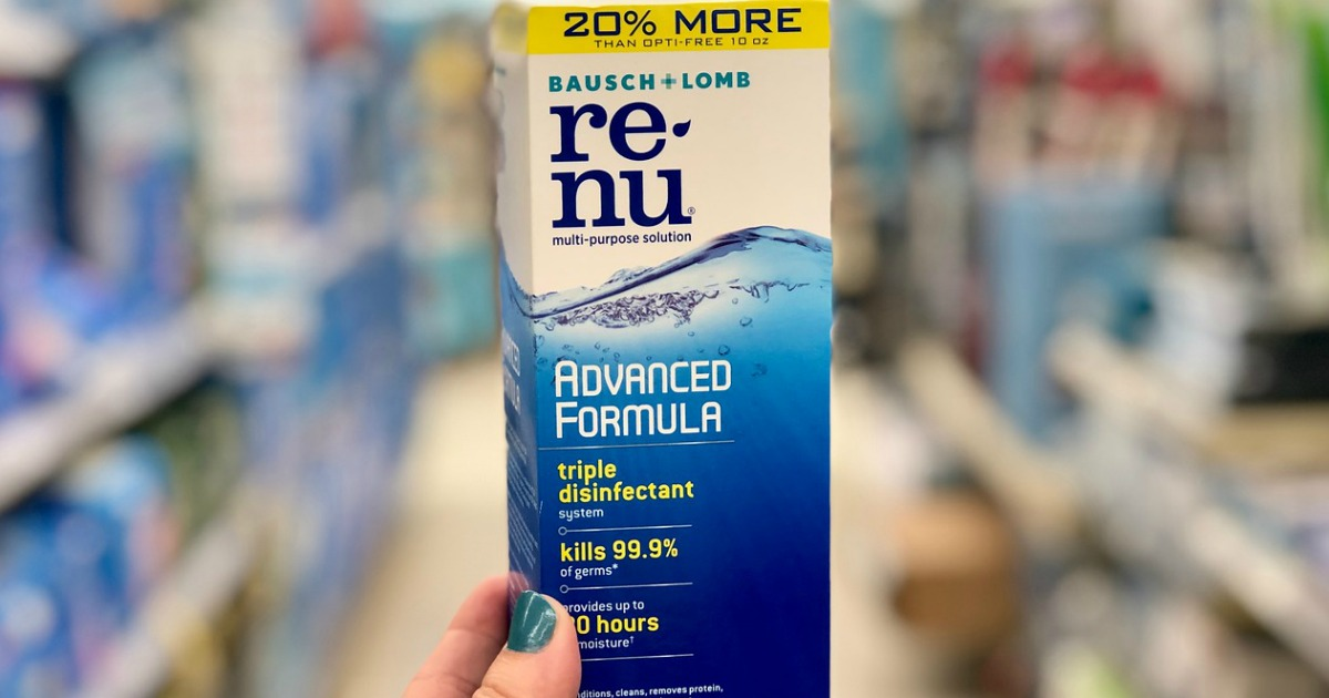 hand holding renu contact lens solution