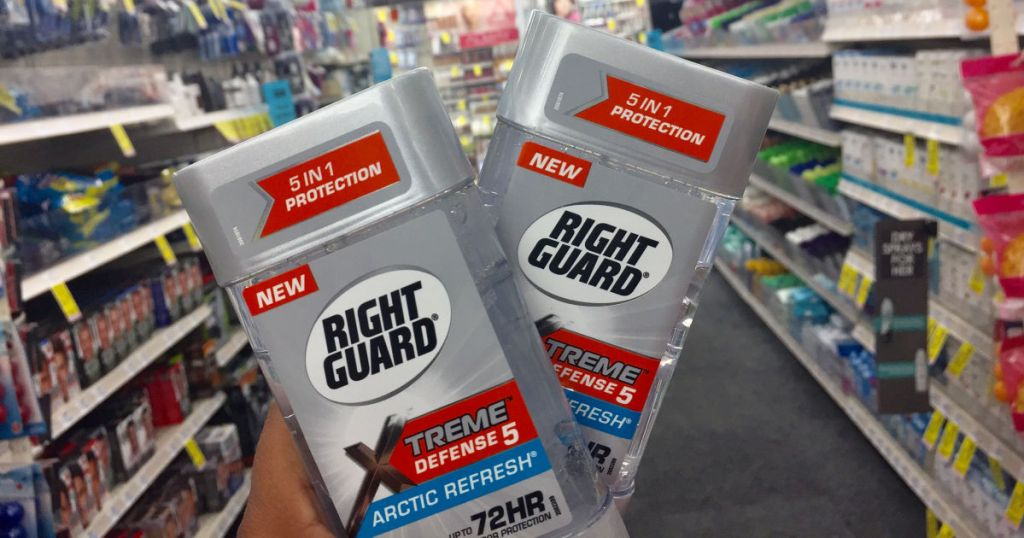 hand holding two right guard deodorants