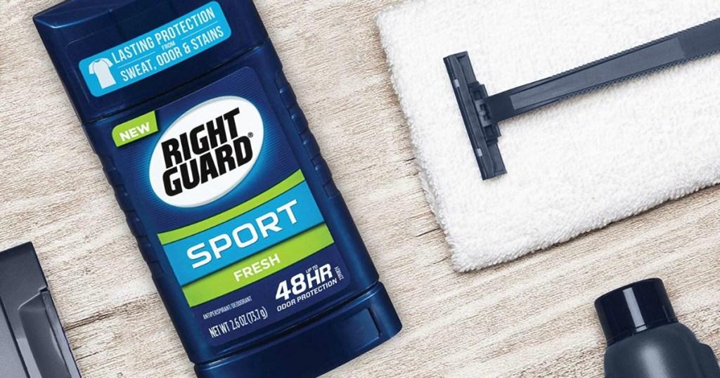 Right Guard deodorant stick next to razor