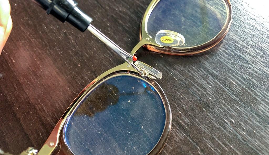 seam ripper used as a small screwdriver