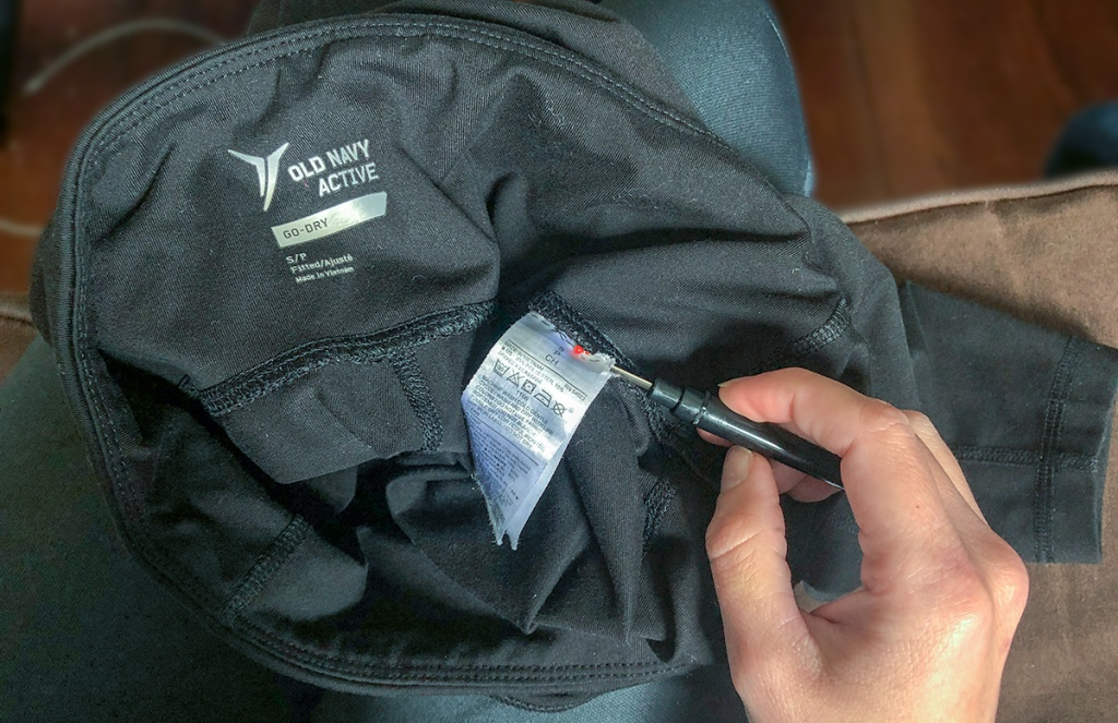 using a seam ripper to remove tags from apparel