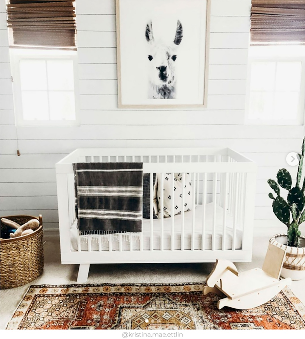 shiplap nursery wall with crib