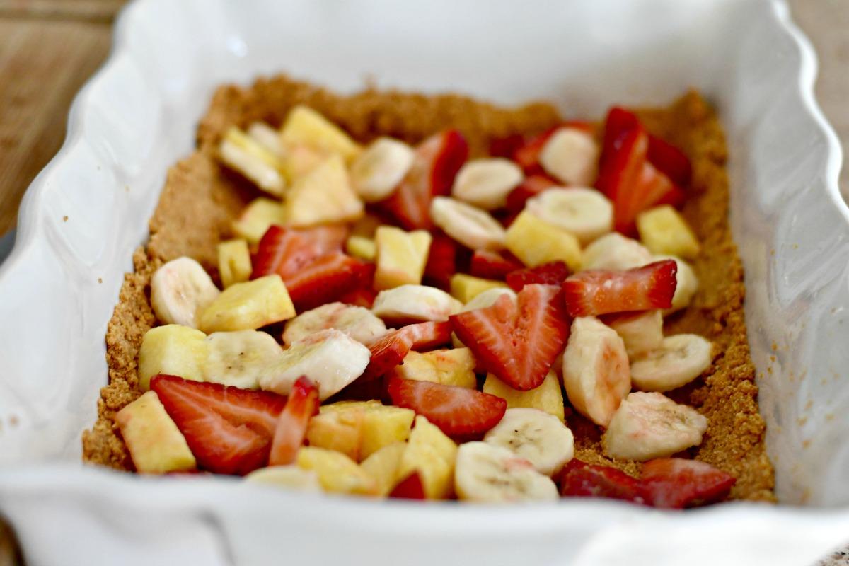 graham cracker crust dessert with fruit layer