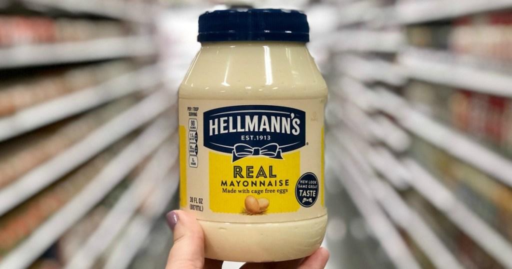 hand holding mayonnaise