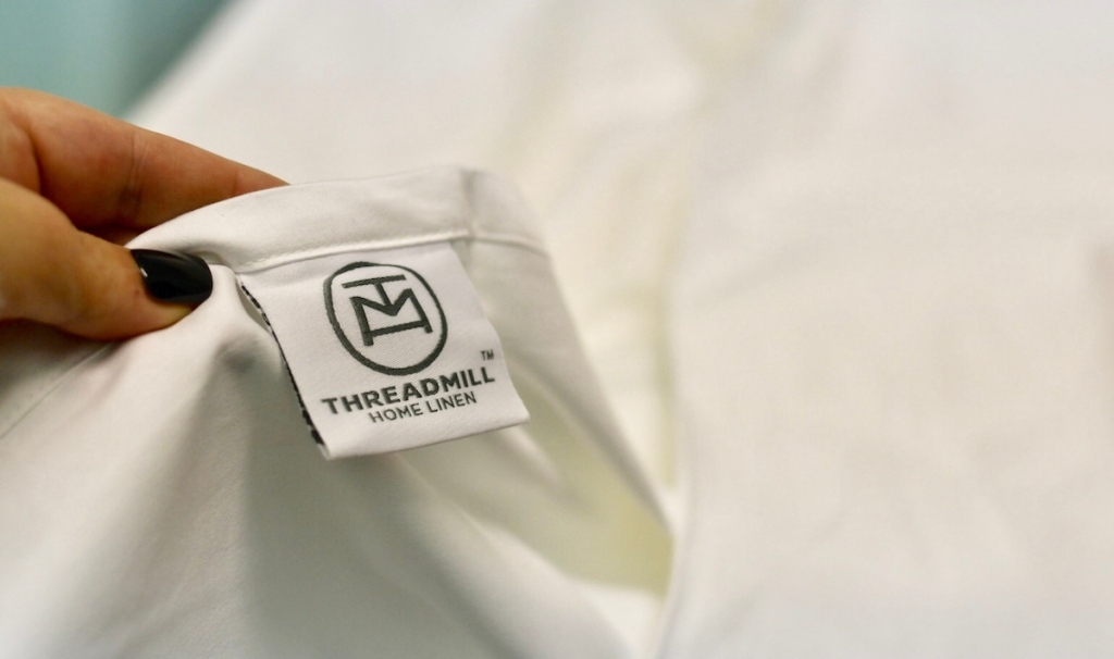hand holding a threadmill sheet with tag