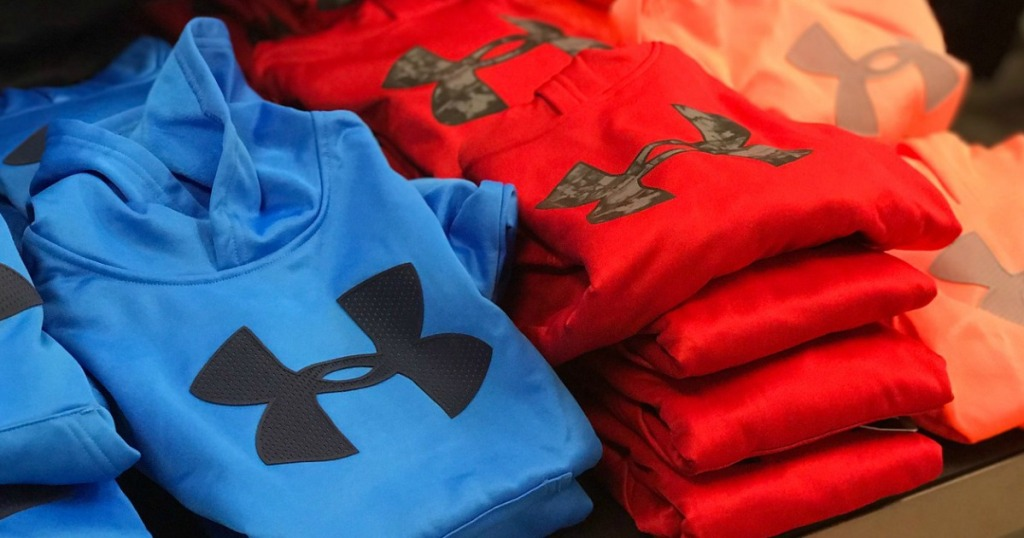 red and blue under armour hoodies folded
