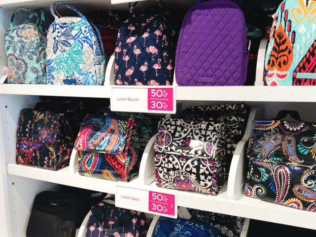 Vera Bradley lunch bags on a shelf at the store
