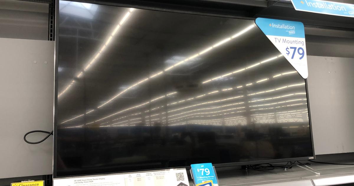"VIZIO 65"" 4K Smart TV HDR M656-G4TV on a shelf in a store"