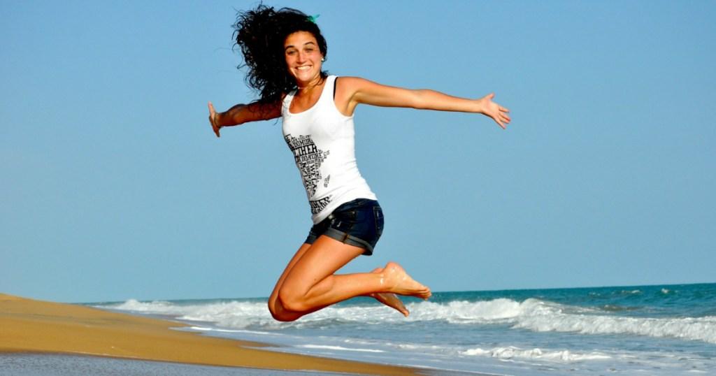 woman jumping at the beach