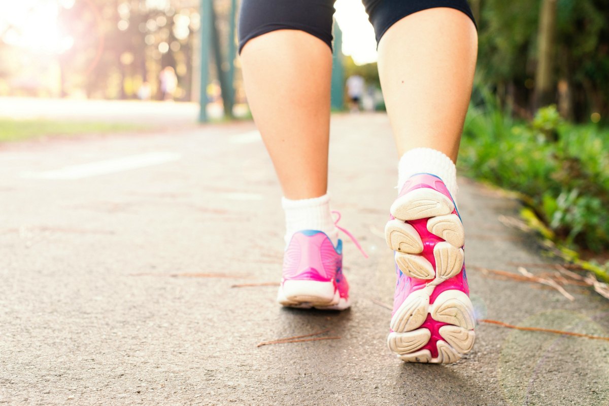 close up of woman wearing sneakers in active step