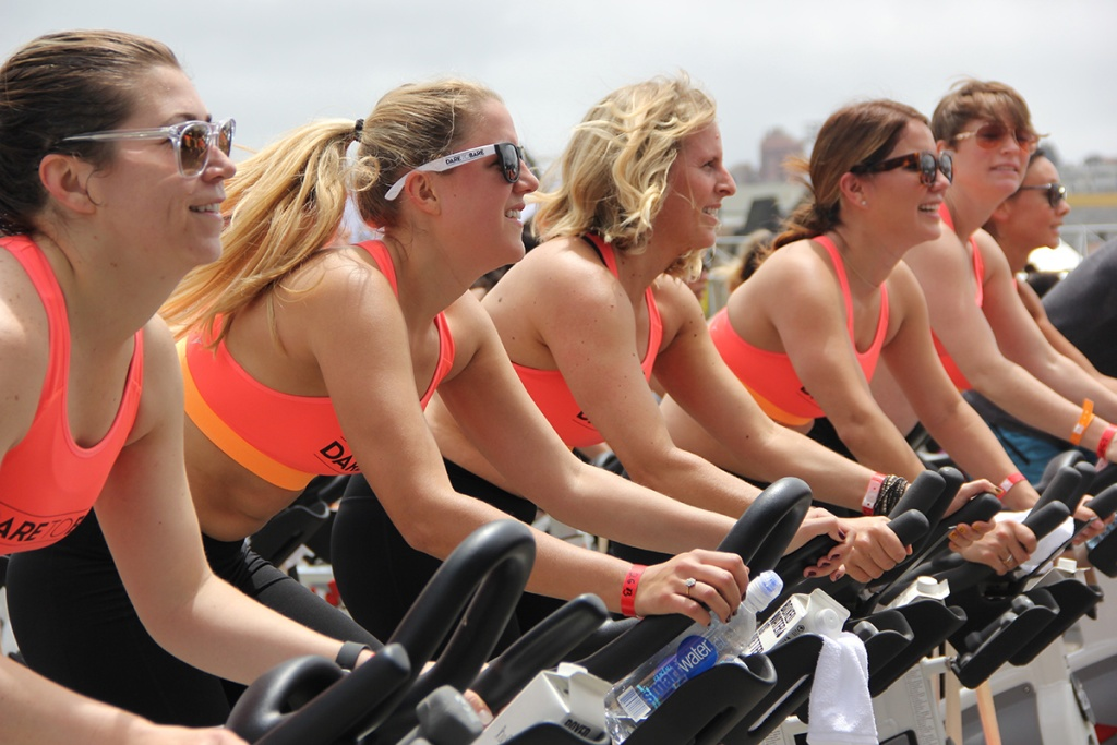 group of women on cycle bikes together working out