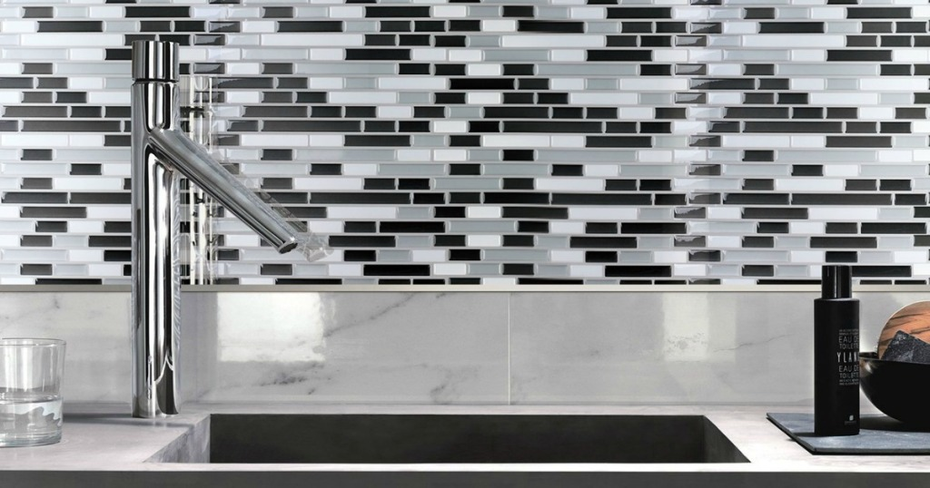 white, black and gray backsplash tiles and sink in kitchen