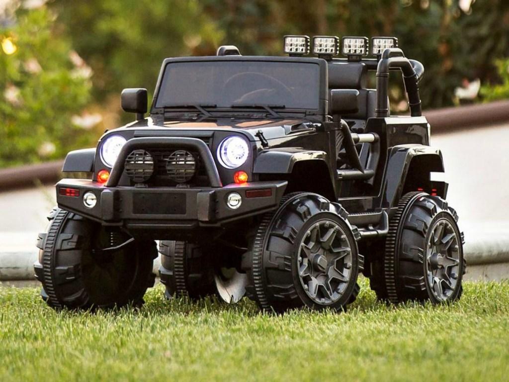 Black kids 12V Jeep riding on grass