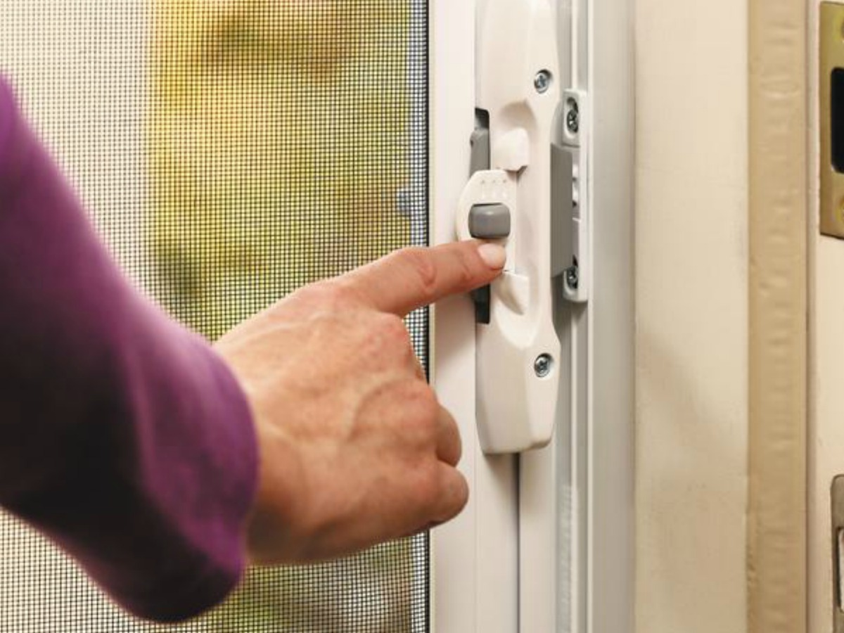 lady touching a Screen door latch