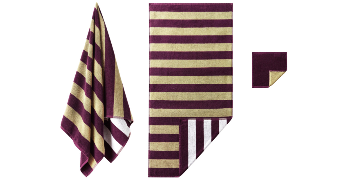two purple and gold striped towels and a washcloth