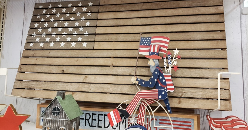 wooden american flag and wooden Uncle Sam riding a bike at Michaels