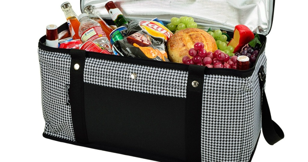 cloth cooler full of fruits, bread, and beverages