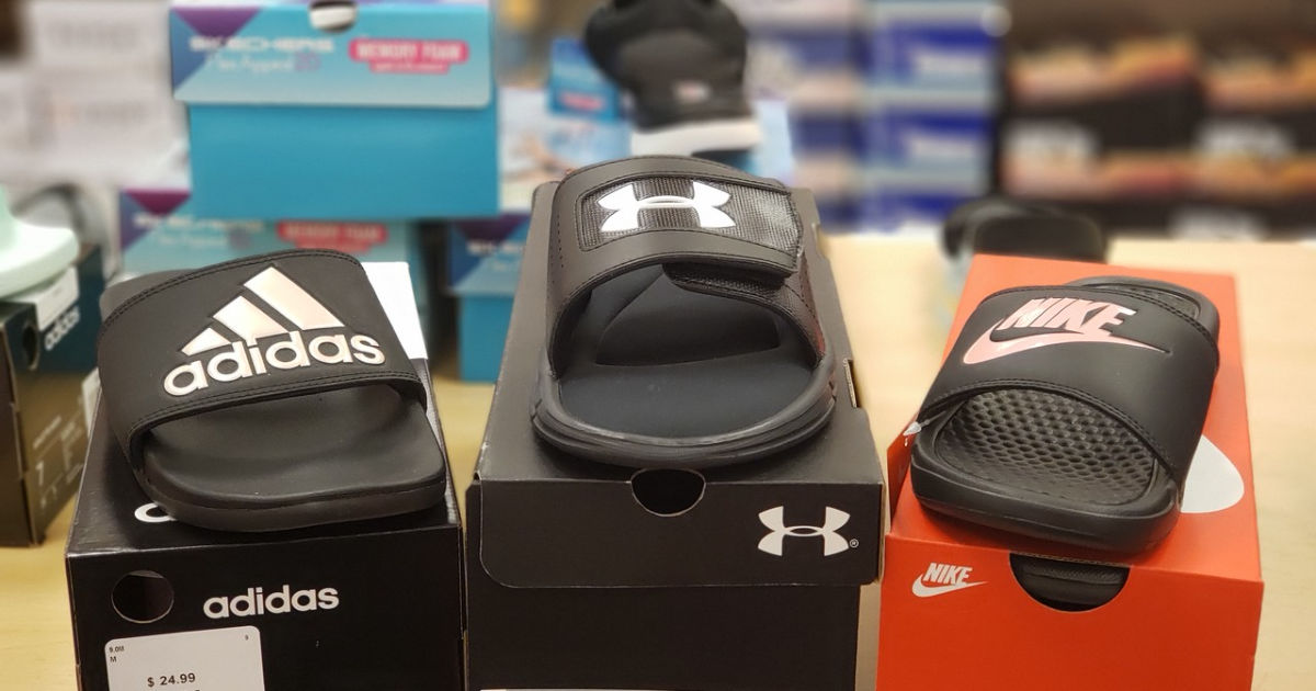 adidas, under armour and nike flip flops displayed on shoes boxes