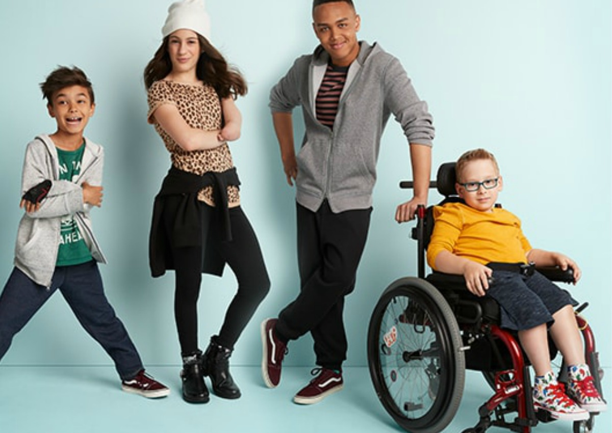 differently-abled kids, three standing and one in a wheelchair