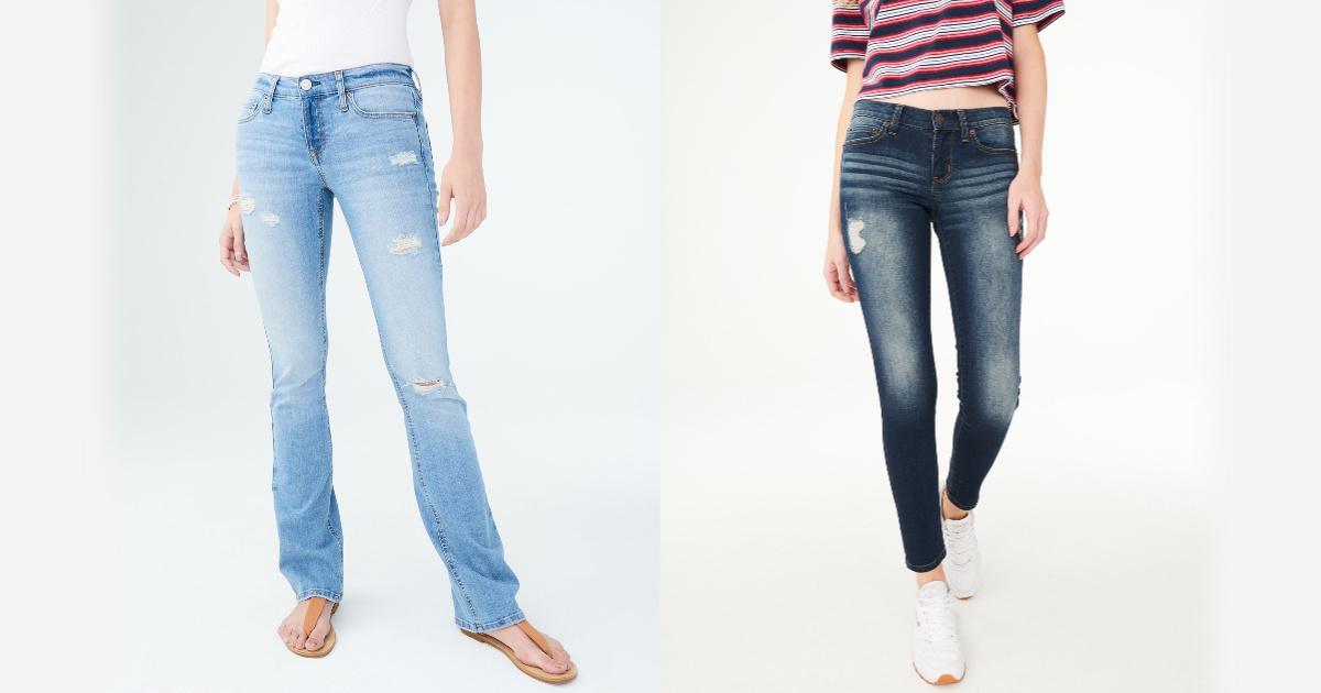 two women wearing distressed jeans