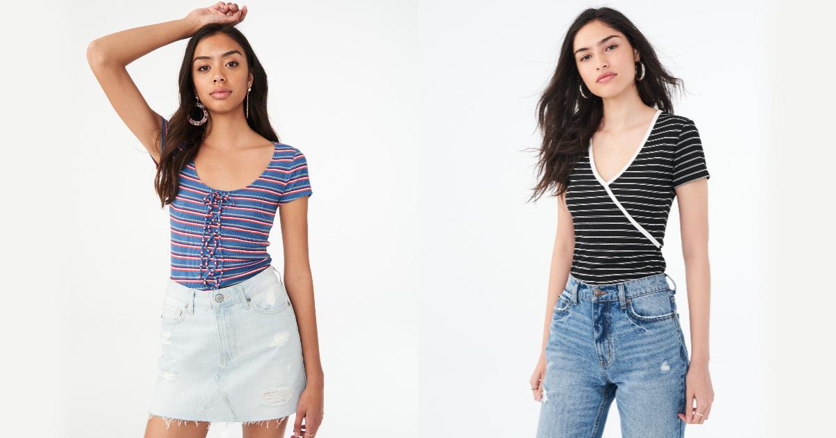 two women wearing striped shirts