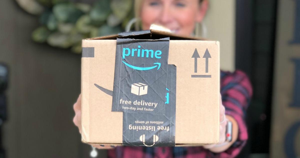 collin holding out Amazon prime box