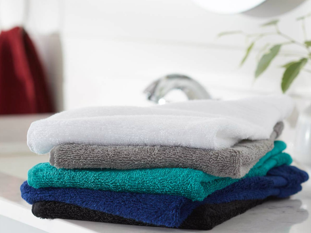 different color washcloths folded on counter