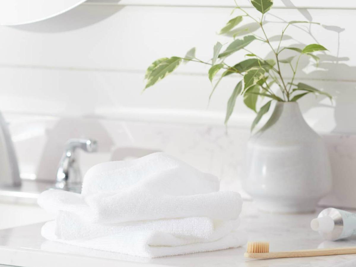 white wash cloths sitting on bathroom counter