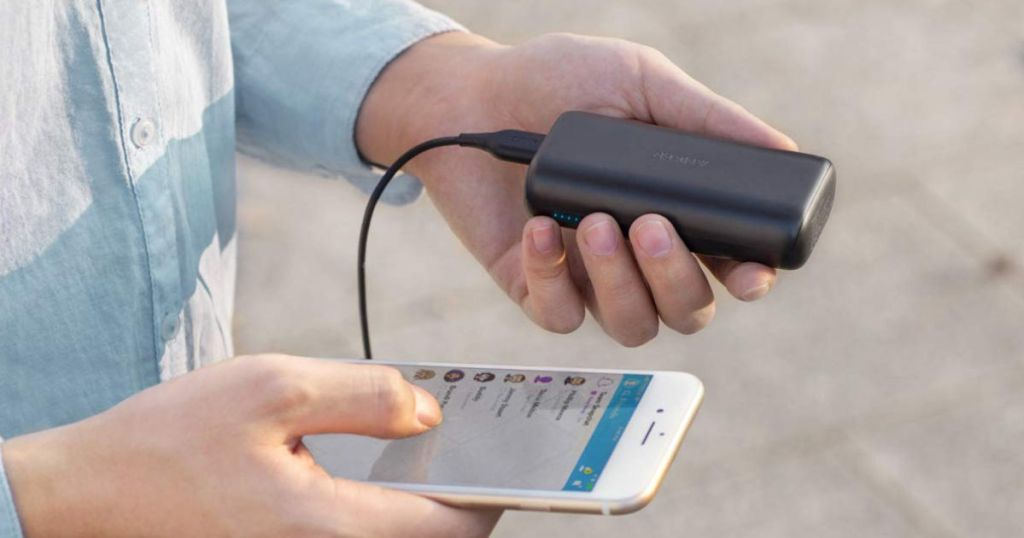 hand holding anker powercore charging iphone using snapchat