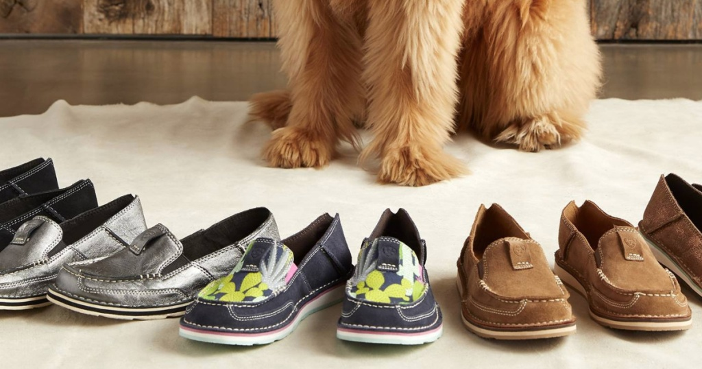 Dog sitting next to Ariat Loafers Slip-On Sneakers