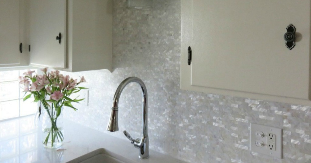 kitchen with mother of pearl tiles on backsplash