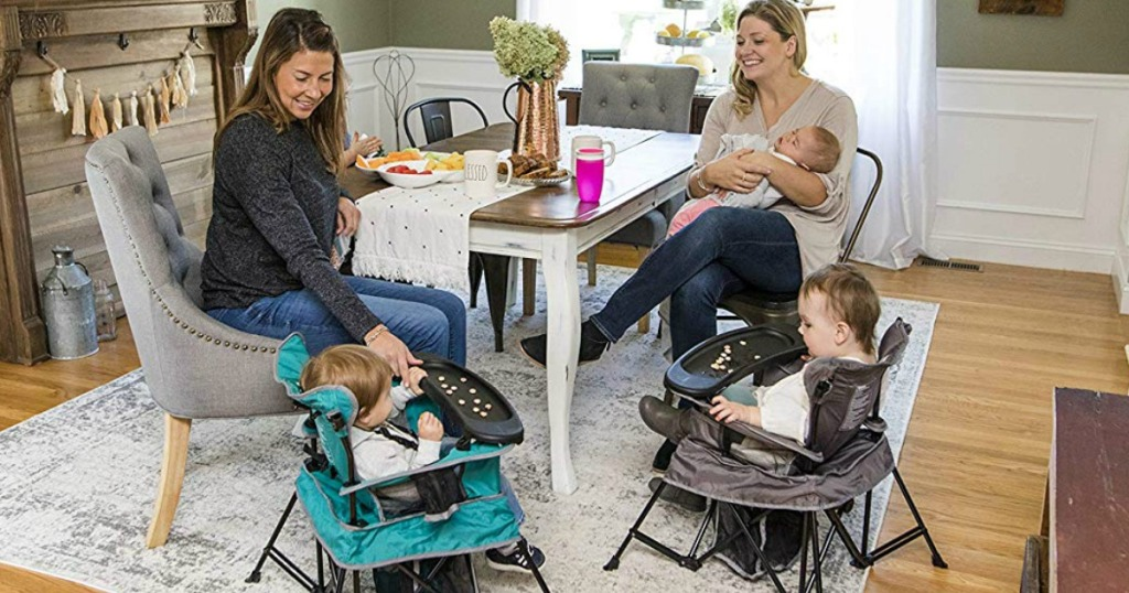 two moms with their children in dining room with portable chairs