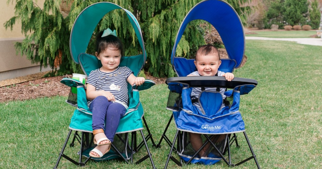 Kids sitting outside in a Baby Delight Go With Me Portable Indoor/Outdoor Chair