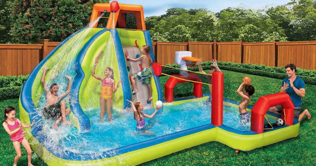 Kids and dad playing on Banzai Aqua Sports Water Park in backyard