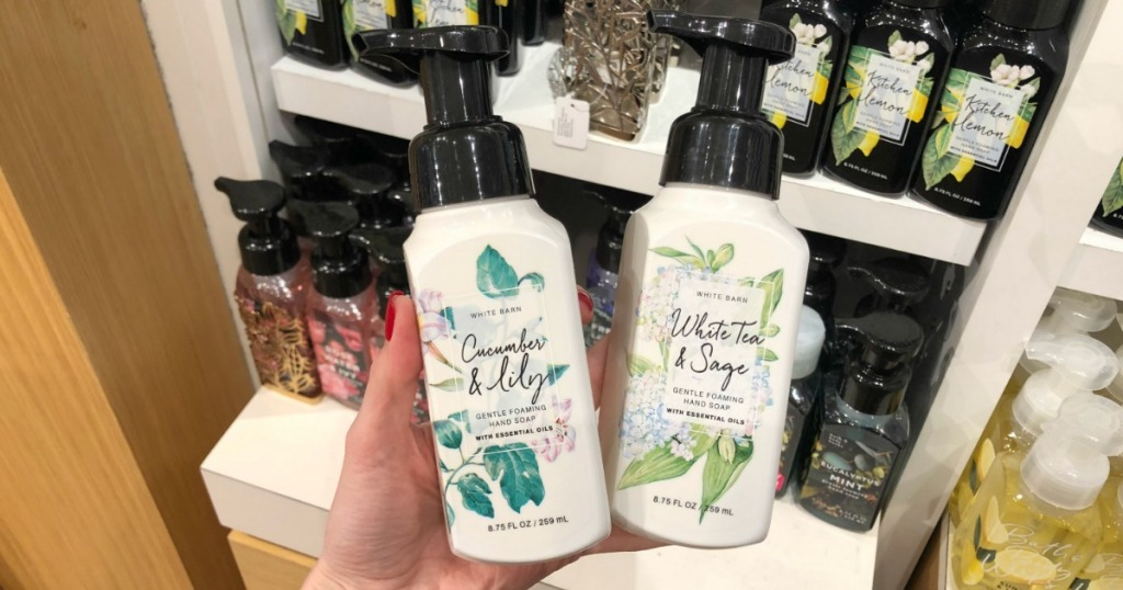 hand holding cucumber & lilly and white tea & sage hand soap at bath and body works
