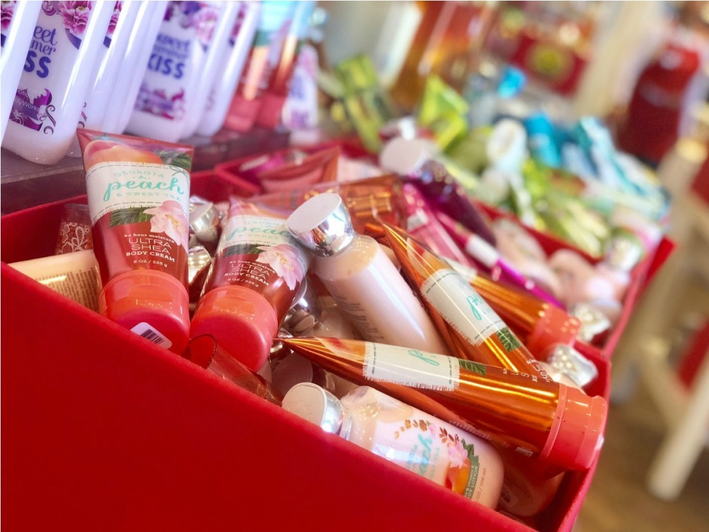 bath body works hand creams and soaps in red bins