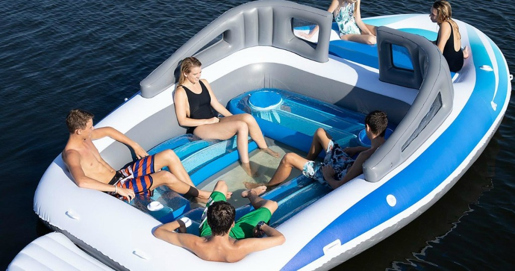 people lounging in a huge inflatable party boat