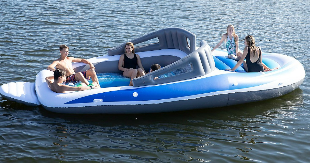 people sitting on inflatable boat in water