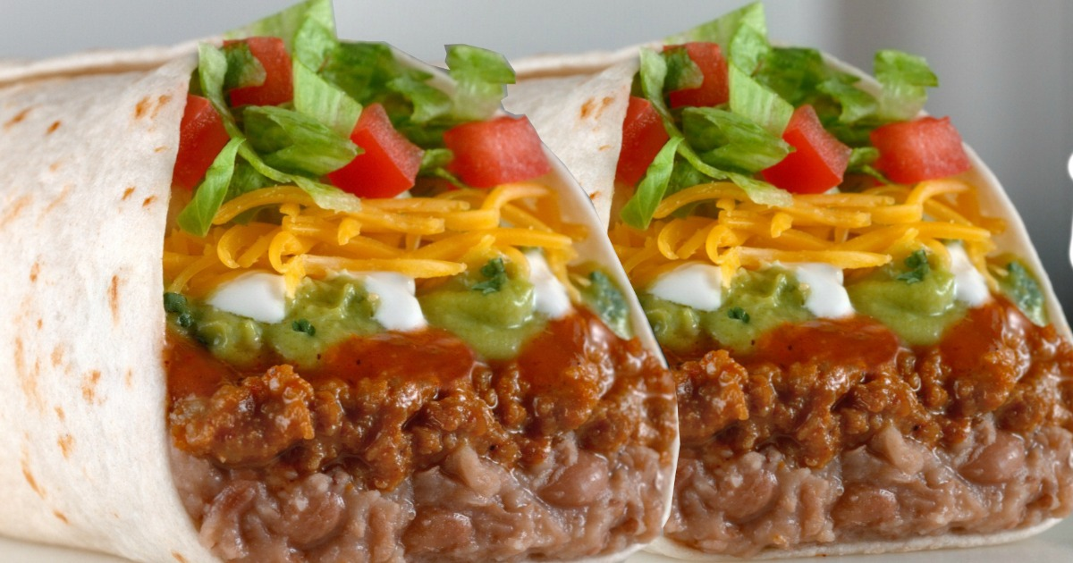 two burritos with lettuce, tomatoes, cheese, and more