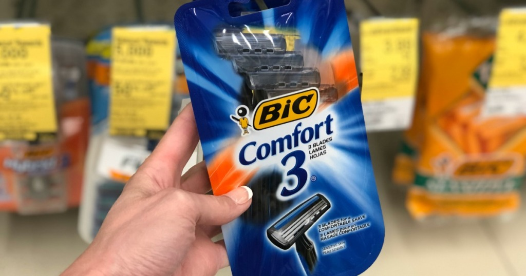 bic comfort 3 disposable razors 4-pack being held in walgreens store